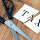 Tax icon being cut with scissors