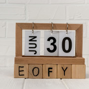 Wooden calendar with cubes and word EOFY